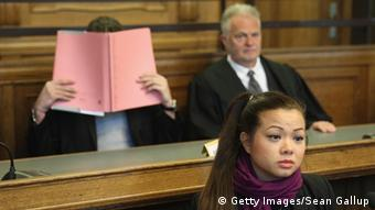 BERLIN, GERMANY - MAY 13: Tina K., sister of victim Jonny K., sits in the courtroom as co-defendant Memet E. covers his face shortly before the trial begin of the six Jonny K. attackers at the Kriminalgericht Moabit court on May 13, 2013 in Berlin, Germany. The six young men are accused of assaulting Jonny K. in front of a bar on Alexanderplatz on October 14, 2012, and beating him so severely that Jonny K. later died of his head injuries. His sister Tina has led a media campaign to draw publicity to the case and the issue of violence in German society. (Photo by Sean Gallup/Getty Images)