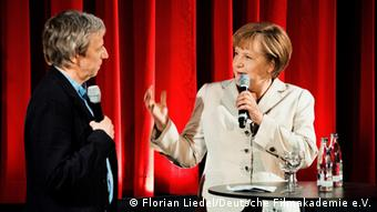 Angela Merkel on stage with the director Andreas Dresen in Berlin.