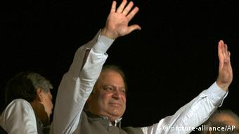 Former Prime Minister and leader of the Pakistan Muslim League-N party Nawaz Sharif waves to his supporters at a party office in Lahore, Pakistan, Saturday, May 11, 2013 (Photo: AP Photo/K.M. Chaudary)