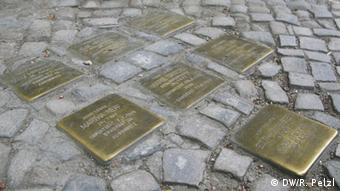 Stolpersteine stumbling Stones side walk Memorials to victims of Nazism