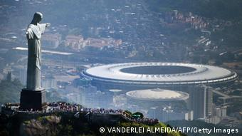 Aerial view of the Christ the Redeemer statue atop Corcovado Hill and the Mario Filho (Maracana) stadium in Rio de Janeiro, Brazil on May 10, 2013. The Maracana stadium will host the upcomig Confederations Cup next June, the Brazil 2014 FIFA World Cup and the 2016 Summer Olympics. AFP PHOTO /VANDERLEI ALMEIDA (Photo credit should read VANDERLEI ALMEIDA/AFP/Getty Images)