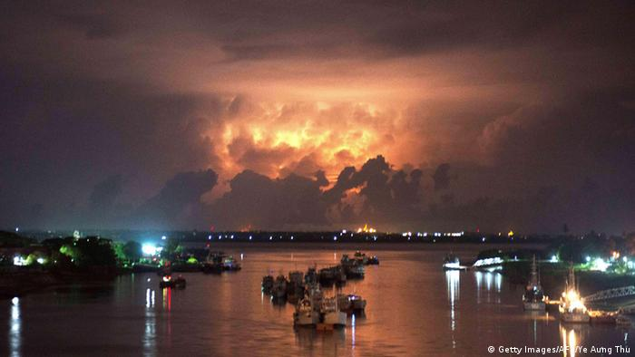 A storm lights up the sky above the Yangon river early on May 13, 2013. Ye Aung Thu/AFP/Getty Images