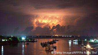 A storm lights up the sky above the Yangon river early on May 13, 2013. Myanmar on May 12 began moving people into emergency shelters as a cyclone threatened to batter a violence-wracked region home to tens of thousands of internal refugees. AFP PHOTO/ Ye Aung Thu (Photo credit should read Ye Aung Thu/AFP/Getty Images)