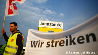 An employee of Amazon takes part in a strike by German united services union Ver.di in front of an Amazon warehouse in Bad Hersfeld May 14, 2013. Banner reads, We strike. REUTERS/Lisi Niesner (GERMANY - Tags: BUSINESS EMPLOYMENT CIVIL UNREST)