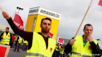 Employees of Amazon take part in a strike by German united services union Ver.di in front of an Amazon warehouse in Bad Hersfeld May 14, 2013. REUTERS/Lisi Niesner (GERMANY - Tags: BUSINESS EMPLOYMENT CIVIL UNREST)