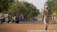 A Malian soldier is seen in Gao during a false alert by the population signaling the presence of MUJAO (Movement for Oneness and Jihad in West Africa) members in a street in Gao on April 13, 2013. Gao fell in March of last year to Tuareg rebels who declared the independence of the entire desert north before losing control to armed Islamists. French warplanes bombed parts of Gao in January to drive out fighters from the MUJAO, and the city was recaptured for the Bamako government by French and Malian forces on January 26. AFP PHOTO / JOEL SAGET (Photo credit should read JOEL SAGET/AFP/Getty Images)