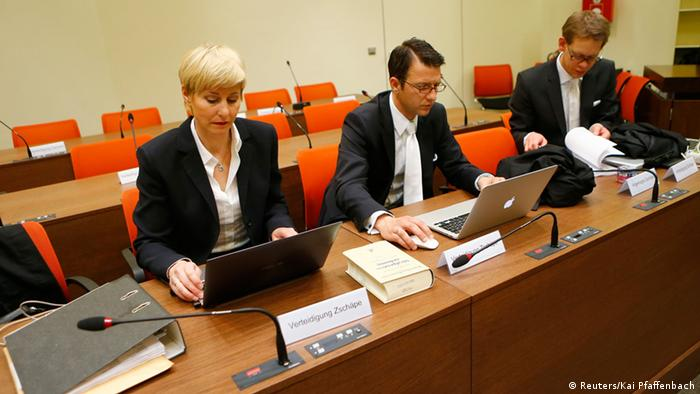 Defence lawyers Anja Sturm (L) Wolfgang Stahl and Wolfgang Heer (R) sit at their desk before proceedings are resumed in the trial of Beate Zschaepe and four others involving neo-Nazi racist murders, in Munich May 14, 2013. The trial against a previously unknown neo-Nazi cell, the National Socialist Underground (NSU), which is accused of murdering nine Turkish and Greek immigrants and a policewoman from 2000 to 2007, resumed on Tuesday. The focus of the trial is 38-year-old woman, Beate Zschaepe, who is accused of being an NSU founder member and faces charges of complicity in the murders, two bombings in Cologne and 15 bank robberies. Four suspected male accomplices are also on trial. The existence of the NSU emerged in November 2011 after Uwe Boehnhardt and Uwe Mundlos of the NSU were found dead in a burnt-out mobile home and the third Zschaepe, gave herself in to police. REUTERS/Kai Pfaffenbach (GERMANY - Tags: CRIME LAW)