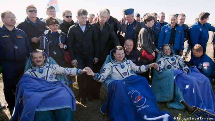 Astronauts retuning from the International Space Station in May 2013 (Photo: Sergei Remezov / REUTERS)