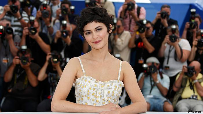 French actress Audrey Tautou, mistress of ceremony of the 66th Cannes Film Festival, poses during a photocall on the eve of the opening of the Festival in Cannes May 14, 2013. The 66th Cannes Film Festival will run from May 15 to May 26. REUTERS/Eric Gaillard (FRANCE - Tags: ENTERTAINMENT)