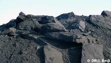 P1150085.JPG Titel: Minas Moatize Schlagworte: Mosambik, Tete, Kohle, Kokskohle, Moatize, Rohstoffe, Bergbau Ort: Moatize, Tete, Mosambik Fotograf: Johannes Beck Datum: 12.11.2012 Beschreibung: Abgebaute Kohle in der Kohlemine Minas Moatize in der nord-mosambikanischen Provinz Tete. Die Mine ist die älteste Kohlemine in der Region und gehört zu den kleinen Abbaugebieten der in Tete vorherrschenden Kokskohle. Die Mine ist Eigentum der britischen Gesellschaft Beacon Hill Resources PLC. Copyright: DW/J. Beck