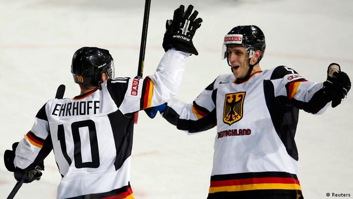 Germany's Christian Ehrhoff (L) celebrates his winning goal with teammate Marcel Goc during overtime in their 2013 IIHF Ice Hockey World Championship preliminary round match against France at the Hartwall Arena in Helsinki May 14, 2013. REUTERS/Grigory Dukor (FINLAND - Tags: SPORT ICE HOCKEY)