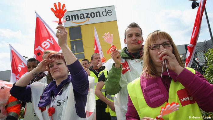 Amazon workers wearing bibs of the ver.di service industry labor union (Photo by Sean Gallup/Getty Images)