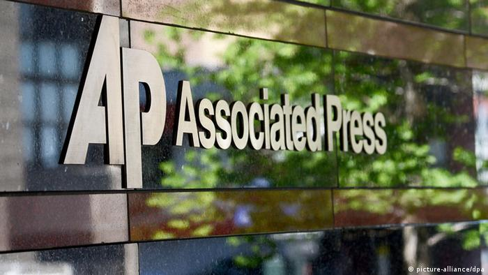Associated Press (AP) logo at the entrance to their office building in New York, New York , USA, 14 May 2013. EPA/ANDREW GOMBERT +++(c) dpa - Bildfunk+++