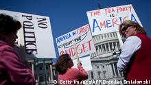 Tea Party activists gather on Capitol Hill April 6, 2011 in Washington, DC. The federal government is facing a potential shutdown on April 8 if members of Congress and the White House are not able to agree on a budget. The White House on Wednesday said that around 800,000 federal employees would be told not to go work and military personnel would miss paychecks if a budget row causes a government shutdown. National parks would also be closed and Washington's annual cherry blossom festival this weekend would also be cancelled, officials said, as pressure mounted before a midnight April 8 deadline to fund the vast US government. AFP PHOTO/Brendan SMIALOWSKI (Photo credit should read BRENDAN SMIALOWSKI/AFP/Getty Images)