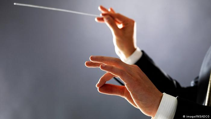 Baton in a conductor's hands