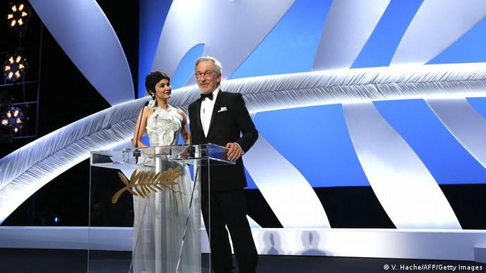 US director and President of the Feature Film Jury Steven Spielberg (R) speaks on May 15, 2013 next to French actress and mistress of ceremonies at the Cannes Film Festival Audrey Tautou during the opening of the 66th edition of the Cannes Film Festival in Cannes. Cannes, one of the world's top film festivals, opens on May 15 and will climax on May 26 with awards selected by a jury headed this year by Hollywood legend Steven Spielberg. AFP PHOTO / VALERY HACHE (Photo credit should read VALERY HACHE/AFP/Getty Images)