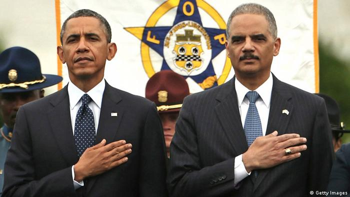 WASHINGTON, DC - MAY 15: (EDITORS NOTE: Retransmission with alternate crop.) U.S. President Barack Obama (L) and Attorney General Eric Holder attend the National Peace Officers' Memorial Service at the U.S. Capitol May 15, 2013 in Washington, DC. Obama, Holder and other members of the administration are being criticized over reports of the Internal Revenue Services' scrutiny of conservative organization's tax exemption requests and the subpoena of two months worth of Associated Press journalists' phone records. (Photo by Chip Somodevilla/Getty Images)
