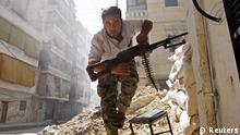 A Free Syrian Army fighter takes cover during clashes with Syrian Army in the Salaheddine neighbourhood of central Aleppo August 7, 2012. REUTERS/Goran Tomasevic (SYRIA - Tags: CIVIL UNREST POLITICS TPX IMAGES OF THE DAY) ATTENTION EDITORS - PICTURE 6 OF 15 FROM REUTERS BOOKS' OUR WORLD NOW 6