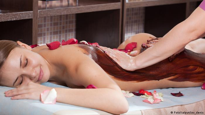 A woman getting a chocolate massage