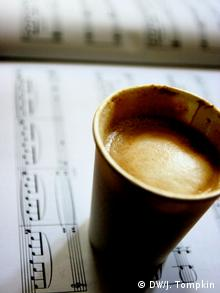 Musical score and coffee cup
