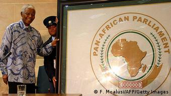 Johannesburg, SOUTH AFRICA: Former South African President Nelson Mandela is presented with a gift as honorary member of the Pan African Parliament Trust fund 13 November 2006 in Johannesburg. uccess in the battles against poverty, unemployment and AIDS is crucial to the viability of democracy in Africa, Nelson Mandela told a meeting of the continent's own parliament todya. AFP PHOTO/FATI MOALUSI (Photo credit should read FATI MOALUSI/AFP/Getty Images)