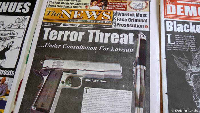 A gun and a pen printed on nigerian newspaper. Photo: Julius Kanubah