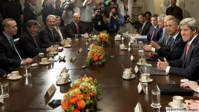 US President Barack Obama (2nd R) and Turkish Prime Minister Recep Erdogan (L) hold a meeting in the Cabinet Room of the White House in Washington, DC, May 16, 2013. Secretary of State John Kerry is seated right. (Photo: SAUL LOEB/AFP/Getty Images)