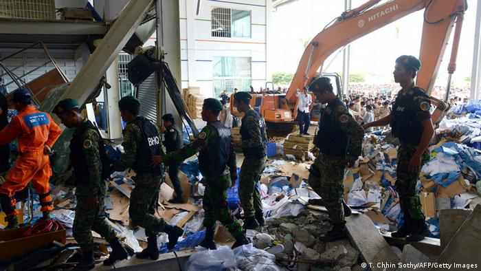 Cambodian shoe factory collapse. Photo: TANG CHHIN SOTHY/AFP/Getty Images.