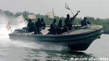 (FILE) A file photograph dated 30 January 2007 shows Nigerian militants patroling in the creeks of the Niger delta region of Southern Nigeria. Three French crewmen have been kidnapped in an attack on a ship in an oilfield off the coast of Nigeria on 21 September 2010. Marine services company Bourbon claims pirates in several speedboats attacked one of its vessels. There has been no claims of responsibility but kidnappings and attacks are frequent in the Niger Delta, the heart of Africa's biggest oil and gas industry. EPA/GEORGE ESIRI