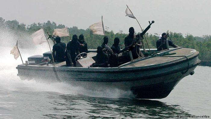 Nigerian militants patrol the creeks of the Niger delta. (Photo: George EsirI)