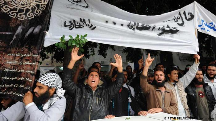 Tunisian Salafists hold banners and shout slogans as they rally in front of a court house in Tunis on November 6, 2012, to demand the release of people arrested in connection with an investigation into the attack on the United States embassy in Tunis on September 14, according to an AFP journalist. AFP PHOTO / FETHI BELAID (Photo credit should read FETHI BELAID/AFP/Getty Images)