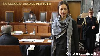 epa03704508 Karima El Mahrough (C), also knowed as Ruby, leaves the Milan Courtroom after the judges questioned her as witness in the trial against show biz manager Lele Mora, journalist Emilio Fede and Nicole Minetti in Milan, Italy, 17 May 2013. A former Moroccan nightclub dancer at the center of Silvio Berlusconi's trial for allegedly paying for sex with a minor on 16 May told she had never seen the former Italian Prime Minister touch any girls at his supposed bunga bunga parties. EPA/STEFANO PORTA +++(c) dpa - Bildfunk+++