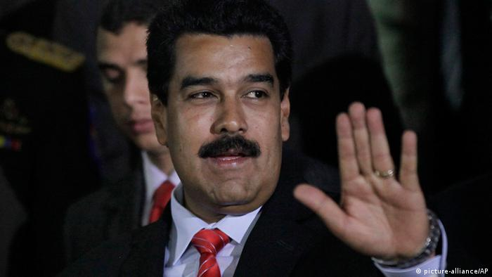 Venezuela's President Nicolas Maduro, gestures at Miraflores Presidential Palace in Caracas, Venezuela, Monday, May 13, 2013. Maduro meet with China's Vice President Ly Yuanchao to ratify agreements between Venezuela and China.(AP Photo/Ariana Cubillos)