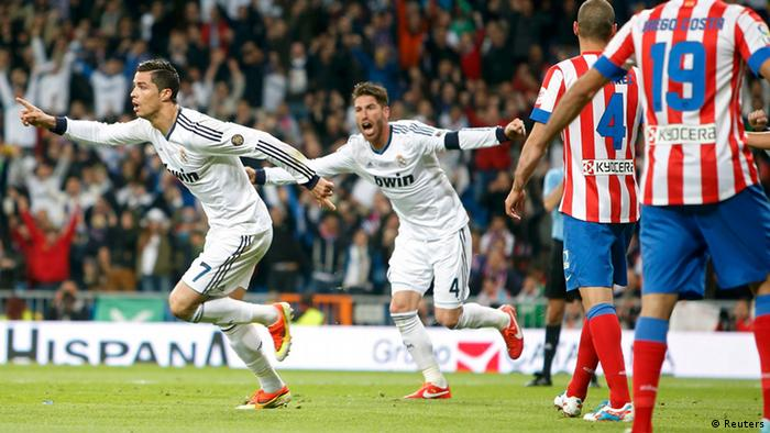 Real Madrid's Cristiano Ronaldo celebrates with team mate Sergio Ramos (C) after scoring a goal against Atletico Madrid during their Spanish King's Cup final soccer match at Santiago Bernabeu stadium in Madrid May 17, 2013. REUTERS/Sergio Perez (SPAIN - Tags: SPORT SOCCER)