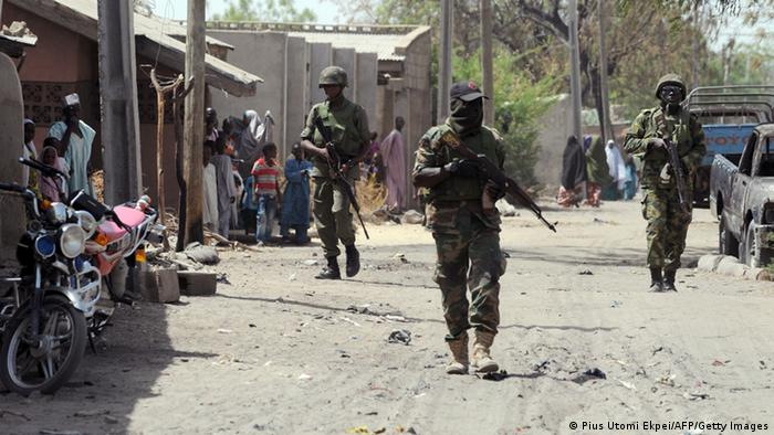 Soldiers walk on April 30, 2013 in the street in the remote northeast town of Baga, Borno State (Photo: PIUS UTOMI EKPEI/AFP/Getty Images)