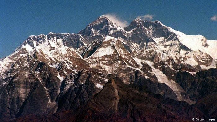 TO GO WITH 'EVEREST-SCHED' (FILES) This November 1996 file photo shows Mount Everest in the Himalayas. May 29, 2003 marks the 50th anniversary of Edmund Hillary and Sherpa Tenzing Norgay's feat of becoming the first men to reach the top of the the world's hightest peak Mount Everest. AFP PHOTO/EPA/DPA/FILES (Photo credit should read MARTIN ATHENSTAEDT/AFP/Getty Images)