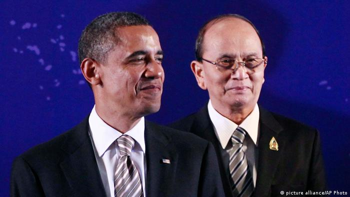 President Barack Obama, left, stands next to Myanmar President Thein Sein during a group photo session at the East Asia Summit in Nusa Dua, on the island of Bali, Indonesia (AP Photo/Charles Dharapak, File)