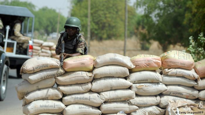 A soldier behind sand bags on a road in Nigeria