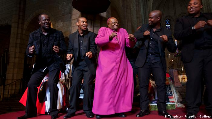 Archbishop Emeritus Desmond Tutu with members of the Cape Town Opera Voice of the Nation Ensemble, at the Templeton Prize celebration at St. George's Cathedral in Cape Town on April 11, 2013. (Photo credit: Templeton Prize: / Ilan Godfrey)
