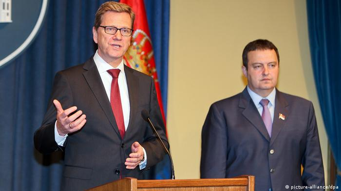 epa03708673 German Foreign Minister Guido Westerwelle (L) and Serbian Prime Minister Ivica Dacic brief the media after their talks in Belgrade, Serbia, 20 May 2013. Westerwelle is on a one-day official visit to Serbia and will later travel to Kosovo. EPA/KOCA SULEJMANOVIC