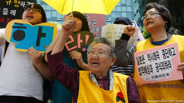 Former South Korean comfort woman Kil Un-ock, center, who was forced to serve for the Japanese troops as a sexual slave during World War II, shouts slogans during a rally against the recent comment of Osaka Mayor Toru Hashimoto in front of Japanese Embassy in Seoul, South Korea, Wednesday, May 15, 2013.