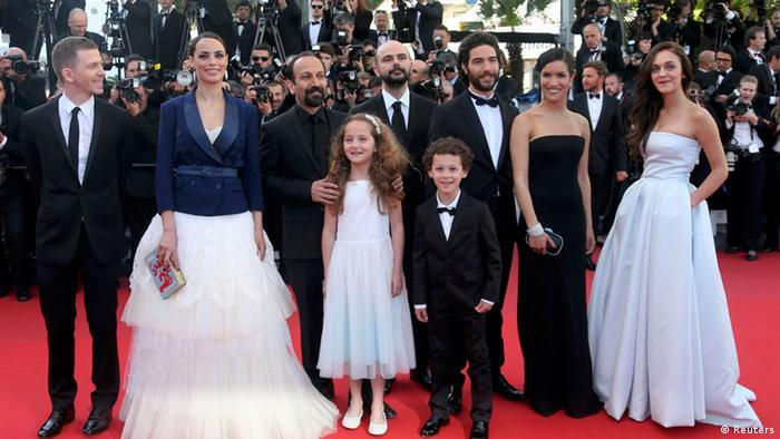 Director Asghar Farhadi (3rdL) poses with producer Alexandre Mallet-Guy, cast members (L-R) Berenice Bejo, Jeanne Jestin, Ali Mosaffa, Elyes Aguis, Tahar Rahim, Sabrina Ouazani and Pauline Burlet on the red carpet as they arrive for the screening of the film 'Le Passe' (The Past) in competition during the 66th Cannes Film Festival in Cannes May 17, 2013. REUTERS/Jean-Paul Pelissier (FRANCE - Tags: ENTERTAINMENT)