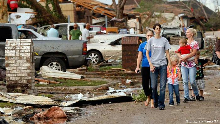 People walk through a neighborhood south of SW 149th between Western and Hudson after a tornado struck south Oklahoma City and Moore, Okla., Monday, May 20, 2013. (AP Photo/ The Oklahoman, Nate Billings)