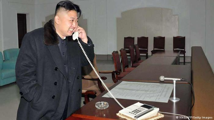 This picture taken by North Korea's official Korean Central News Agency (KCNA) on December 12, 2012 shows North Korean leader Kim Jong-Un celebrating the launch of the Unha-3 rocket, carrying the satellite Kwangmyongsong-3, at the general satellite control and command center in Pyongyang. Hundreds of thousands of North Korean soldiers and civilians rallied on December 14 in the centre of Pyongyang for a mass celebration of the country's long-range rocket launch, state television showed. AFP PHOTO / KCNA vis KNS ---EDITORS NOTE--- RESTRICTED TO EDITORIAL USE - MANDATORY CREDIT AFP PHOTO / KCNA VIA KNS - NO MARKETING NO ADVERTISING CAMPAIGNS - DISTRIBUTED AS A SERVICE TO CLIENTS (Photo credit should read KNS/AFP/Getty Images)