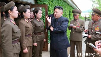 North Korean leader Kim Jong-un (C) inspects Korean People's Army Unit 405 at an undisclosed location in this picture released by the North's KCNA news agency in Pyongyang May 21, 2013. REUTERS/KCNA (NORTH KOREA - Tags: POLITICS MILITARY) ATTENTION EDITORS - THIS PICTURE WAS PROVIDED BY A THIRD PARTY. REUTERS IS UNABLE TO INDEPENDENTLY VERIFY THE AUTHENTICITY, CONTENT, LOCATION OR DATE OF THIS IMAGE. FOR EDITORIAL USE ONLY. NOT FOR SALE FOR MARKETING OR ADVERTISING CAMPAIGNS. THIS PICTURE IS DISTRIBUTED EXACTLY AS RECEIVED BY REUTERS, AS A SERVICE TO CLIENTS