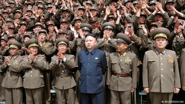 North Korean leader Kim Jong-un (C) poses with troops of Korean People's Army Unit 405 at an undisclosed location in this picture released by the North Korea's KCNA news agency in Pyongyang May 21, 2013. REUTERS/KCNA