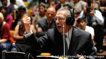 Jose Efrain Rios Montt raises a fist during his 2013 testimony (Johan Ordonez/AFP/Getty Images)