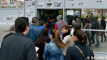 People line up at an employment office in Badalona, near Barcelona, April 25, 2013. More than six million Spaniards were out of work in the first quarter of this year, raising the jobless rate in the euro zone's fourth biggest economy to 27.2 percent, the highest since records began in the 1970s. The stickers on the wall read, Unemployment. REUTERS/Albert Gea (SPAIN - Tags: BUSINESS EMPLOYMENT)