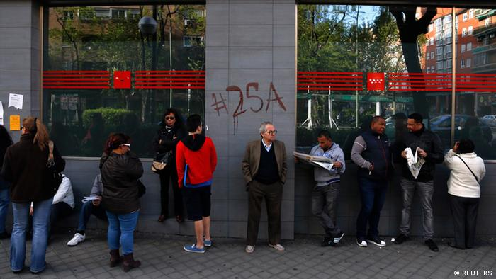 People wait in a queue to enter a government-run employment office in Madrid REUTERS/Sergio Perez