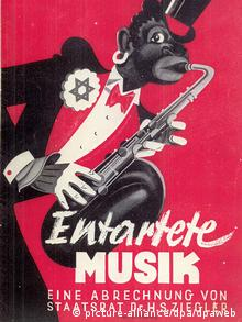 The black jazz musician Jonny is caricatured by the Nazis as a monkey in a poster for the Entartete Musik exhibition (c) picture-alliance/dpa/dpaweb